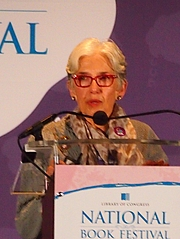 """Author photo. reading at National Book Festival By Slowking4 - Own work, GFDL 1.2, <a href=""""https://commons.wikimedia.org/w/index.php?curid=62180034"""" rel=""""nofollow"""" target=""""_top"""">https://commons.wikimedia.org/w/index.php?curid=62180034</a>"""