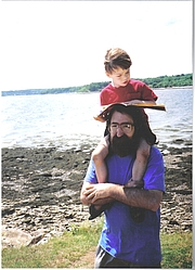 Author photo. Fred Burwell and always reading son in Maine