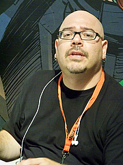 Author photo. Signing at DC Comics booth, Comic-Con International 2009, photo by Loren Javier