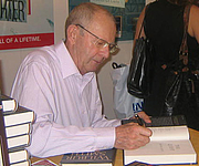 Author photo. Best selling novelist Wilbur Smith signs The Quest at the Tor/Forge booth.