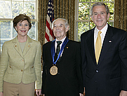 Author photo. 2006 National Medal of Arts recipient and literary translator Gregory Rabassa with President and Mrs. Laura Bush