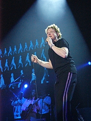 Author photo. Lead singer Mick Hucknall (Photo credit: Wikipedia user Mi.O, Bremen, Germany, 2003-12-01)