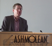 Author photo. Andrew Robinson delivering a talk on the history of India at the Ashmolean Museum, Oxford, England, on 10 May 2014 [credit: Wikimedia Commons user Jpbowen]