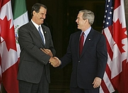 Author photo. President Bush greets Mexican President Vicente Fox at the beginning of meetings between the U.S., Mexico and Canada at Baylor University in Waco, TX, Wednesday, March 23, 2005. White House photo by Krisanne Johnson (georgewbush-whitehouse.archives.gov)