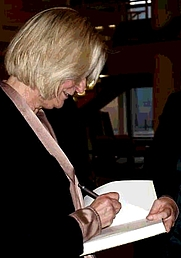 "Author photo. Kirsten Boie signing a copy of ""Der Junge, der Gedanken lesen konnte"" at the opening night of the 'islands of books', Berlin 2012"
