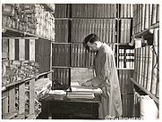 Author photo. Harry Cobb, assistant clerk of the records, working in the Victoria Tower, c.1957.