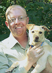 Author photo. Alan Tucker, author of the Mother-Earth Book Series, and the family puppy, Penny, enjoying the sunshine.