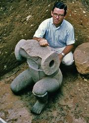 Author photo. Michael D. Coe with Monument 34 of San Lorenzo