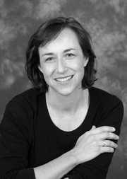 Author photo. Author smiles in black and white publicity photo. / Booked Out Agency