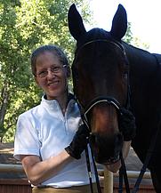 Author photo. Melanie Nilles and her horse, H.H. Beauregarde. Photo by Kiri Stone.