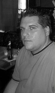 "Author photo. John Klima at a ""Fantastic Fiction"" reading at KGB Bar in New York, NY"