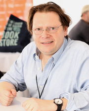 """Author photo. Author Edward Carey at the 2018 Texas Book Festival in Austin, Texas, United States. By Larry D. Moore, CC BY-SA 4.0, <a href=""""https://commons.wikimedia.org/w/index.php?curid=74340401"""" rel=""""nofollow"""" target=""""_top"""">https://commons.wikimedia.org/w/index.php?curid=74340401</a>"""