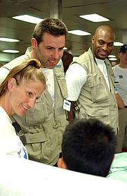 Author photo. Kurt Warner (center) photo by Journalist 3rd Class Isaac Needleman