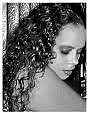 Author photo. Lilith Dorsey, author, priestess and filmmaker in black and white.