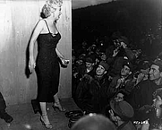 """Author photo. Marilyn Monroe appearing with the USO Camp Show, """"Anything Goes,"""" poses for the shutterbugs after a performance at the 3d U.S. Infantry Division area. Feb. 17, 1954"""