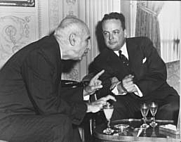 Author photo. Prime Minister Mohammed Mossadegh of Iran (left) visiting with McGhee at the Egyptian Embassy in Washington, D.C. - U.S. Department of State photo, 1951 (trumanlibrary.org)