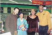Author photo. Author and ESSENCE Magazine Editorial Director Susan L. Taylor, second from right next to author-poet Aberjhani at a book signing in Savannah, Georgia. At far left is Kephra Burns, Taylor's husband and co-author on CONFIRMATION, standing next to Velma Was