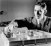 Author photo. Claude Shannon's clever electromechanical mouse, which he called Theseus, was one of the earliest attempts to &quot;teach&quot; a machine to &quot;learn&quot; and one of the first experiments in artificial intelligence. Both photos taken from <a href=&quot;http://www.bell-labs.com/news/2001/february/26/1.html&quot; rel=&quot;nofollow&quot; target=&quot;_top&quot;>http://www.bell-labs.com/news/2001/february/26/1.html</a>)