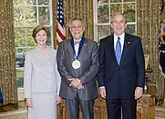 Author photo. Pres. George W. Bush and Laura Bush with jazz musician Paquito D'Rivera, recipient of the 2005 National Medal of Arts