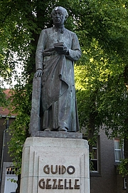 Author photo. Statue of Guido Gezelle in Bruges.