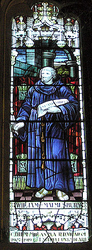 Author photo. Stained glass window showing William of malmesbury, installed in Malmesbury Abbey in 1928 in memory of Rev. Canon C. D. H. McMillan, Vicar of Malmesbury from 1907 to 1919. Taken by Adrian Pingstone in February 2005 and released to the public domain.