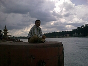 Author photo. Author Aporva kala sitting on the banks of River ganga at Rishikesh, India