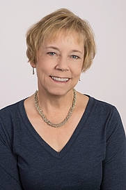 Author photo. Headshot of KC Cowan, author