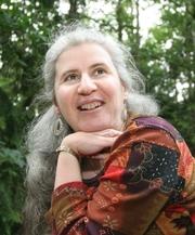 Author photo. Alma Alexander at home