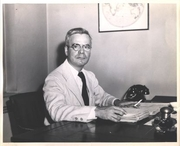 Author photo. John Beecroft at his desk at Doubleday