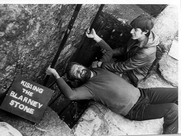 Author photo. André Jute kissing the Blarney Stone