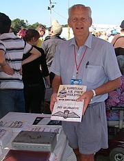 Author photo. Prop Geldenhuys with copies of his book at the Virginia Air-Show, Durban