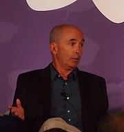 "Author photo. reading at National Book Festival By Slowking4 - Own work, GFDL 1.2, <a href=""https://commons.wikimedia.org/w/index.php?curid=62180044"" rel=""nofollow"" target=""_top"">https://commons.wikimedia.org/w/index.php?curid=62180044</a>"