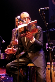 Author photo. Jules Deelder performing with the New Cool Collective.