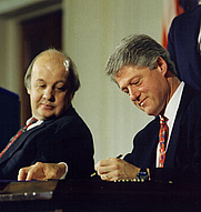 Author photo. Signing handgun control legislation with advocate James Brady in the East Room, November 30.