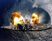 "Author photo. USS Iowa (BB-61) fires a full broadside of nine 16""/50 and six 5""/38 guns during a target exercise near Vieques Island, Puerto Rico, 1 July 1984.