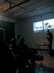 Author photo. David Joselit lectures at Light Industry, Brooklyn NY, 2009