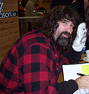 Author photo. Mick Foley (and Socko) at book signing at an Easons store in Dublin, Ireland. By paula from Dublin, Ireland - Flickr, CC BY 2.0, <a href=&quot;https://commons.wikimedia.org/w/index.php?curid=1981878&quot; rel=&quot;nofollow&quot; target=&quot;_top&quot;>https://commons.wikimedia.org/w/index.php?curid=1981878</a>