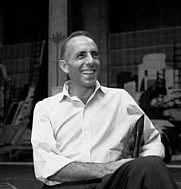 Author photo. Jerome Robbins sitting on chair during rehearsal for West Side Story.<br>   Courtesy of the <a href=&quot;http://digitalgallery.nypl.org/nypldigital/id?1090602&quot;>NYPL Digital Gallery</a> (image use requires permission from the New York Public Library)