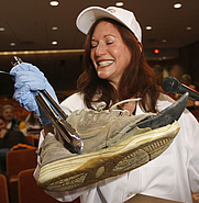 "Author photo. Rachel Herz, author of the book ""Scent of Desire, uses tongs to handle a smelly pair of sneakers while judging the annual Odor-Eaters Rotten Sneaker Contest in Montpelier, Vt. Ben Russell, 15, of Alaska, beat seven other contestants to claim the title of rottenest sneakers in the USA."