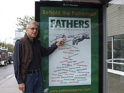 Author photo. Andre Gerard with a bus stop billboard for Fathers: A Literary Anthology