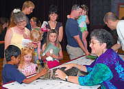 """Author photo. Cathy Conheim and Henry the Cat, author and star of the best-selling children's book, """"What's the Matter with Henry?"""" have a meet and greet with military families at the read and learn event held at the Scottish Rite Center, June 28, 2007. (navy.mil)"""