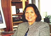 Author photo. Thelma Buchholdt in her office while working as Director of the Equal Employment Opportunity (EEO) program, Office of the Governor, State of Alaska. Photo circa 2000.