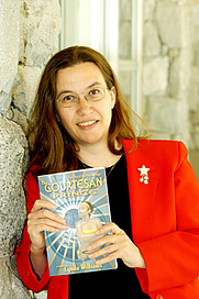 Author photo. Lynda Williams with Book #1 of the Okal Rel Saga, The Courtesan Prince