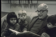 Author photo. portrait of H.A.Rey in early seventies reading to children at Cambridge Adult Education Center by Elsa Dorfman, www.elsa.photo.net