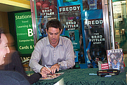 Author photo. Signing at Angus & Roberston bookstore, Pitt Street Mall, Sydney, by Flickr user the Pen