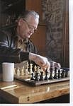 Author photo. Author at chess board. Taken from here: <a href=&quot;http://boardgamegeek.com/image/625867/b-dennis-sustare?size=small&quot; rel=&quot;nofollow&quot; target=&quot;_top&quot;>http://boardgamegeek.com/image/625867/b-dennis-sustare?size=small</a>
