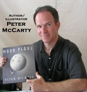 """Author photo. Peter McCarty, author/illustrator, holding """"Moon Plane"""" @ the Baltimore Book Festival. ©2009."""