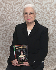 Author photo. JW and some of her print books