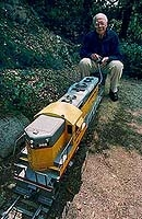 Author photo. Ollie Johnston running his backyard train ~ Photo by J. E. Nystrom, 1993