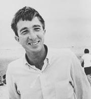 "Author photo. ""John Updike Laughing at Crane Beach"" credit: Dennis Stock"